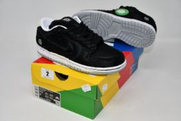 A pair of as new Nike Be @ Brick SB Dunk Low OG (UK 4).