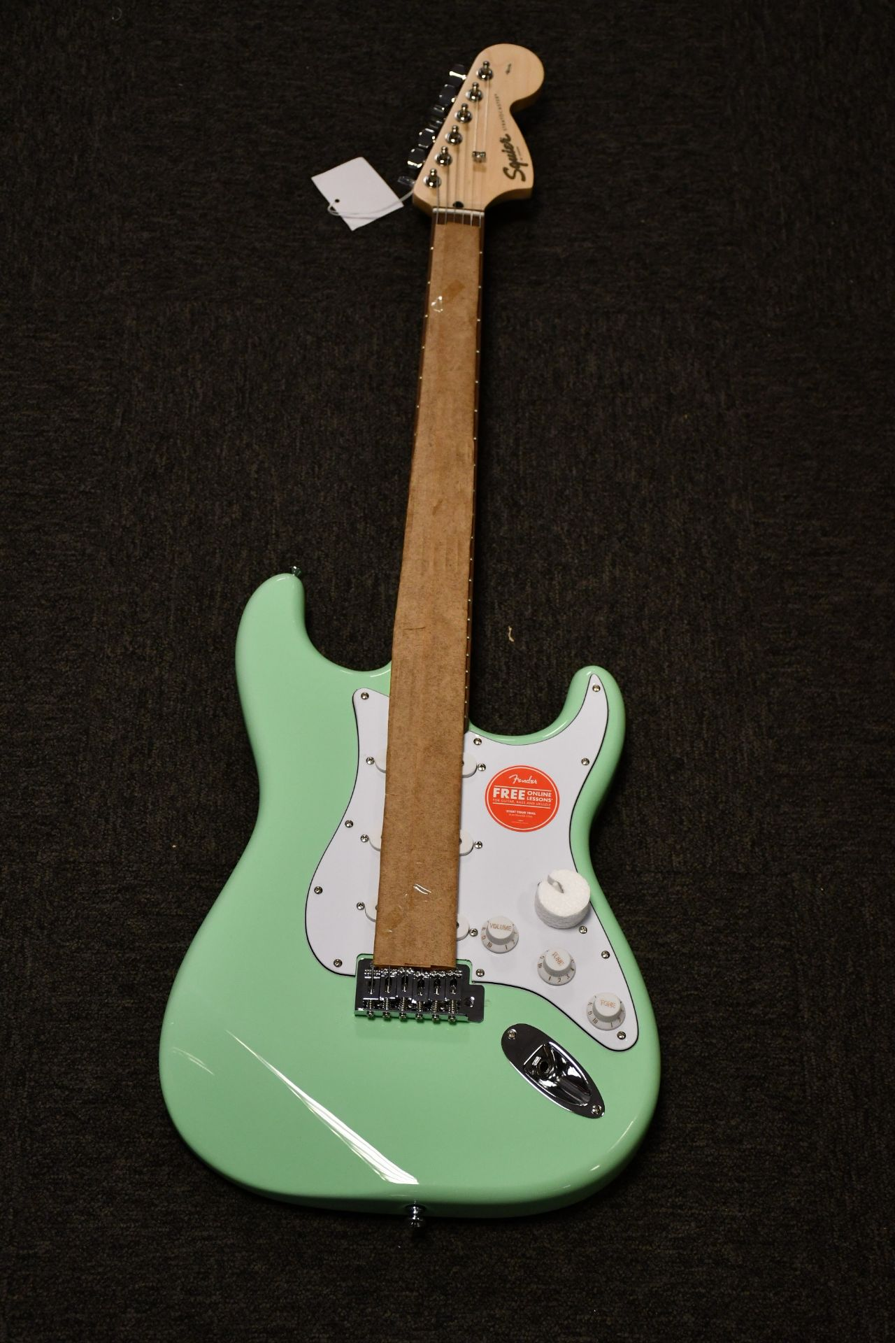 A boxed as new Fender Squier Affinity Series Stratocaster electric guitar in surf green.