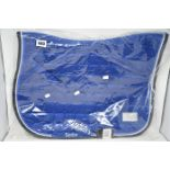 Two boxed as new Equito horse saddle pad in red and blue.