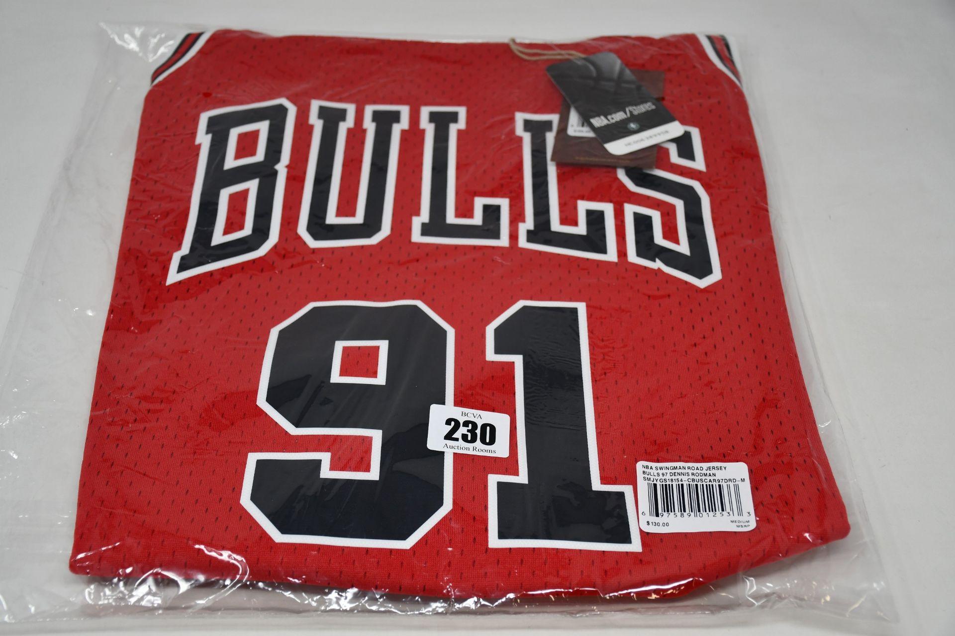 An as new Mitchell & Ness replica NBA Swingman Road jersey Bulls 97 Dennis Rodman (M - RRP $130).