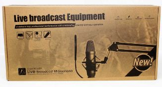 A boxed as new Legendary Live Broadcasting & Recording Microphone.