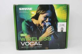 A boxed as new Shure BLX24 PG58 Wireless Microphone and Transmitter (Box opened).
