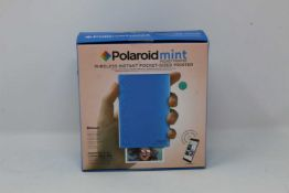 A boxed as new Polaroid Mint Wireless Instant Pocket Printer in Blue (M/N: POLMP02BL) (Box sealed).