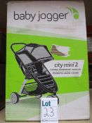 A boxed Baby Jogger City Mini 2 three wheel light weight stroller (Cosmetic damage to outer box).