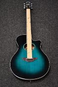A boxed as new Yamaha APX600 electro acoustic guitar in oriental blue.