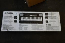 A boxed as new Yamaha PSR-E360W keyboard.