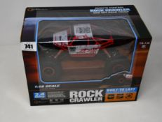 Six boxed as new Top Race Rock Crawler remote controlled car (1:18 scale).