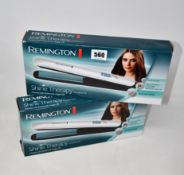 Nine boxed as new Remington Shine Therapy hair straighteners S8500.