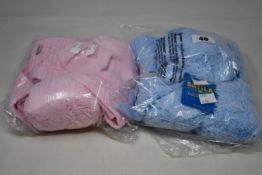 Six children's as new Satila Malva hats in light blue (45) and pink (49).