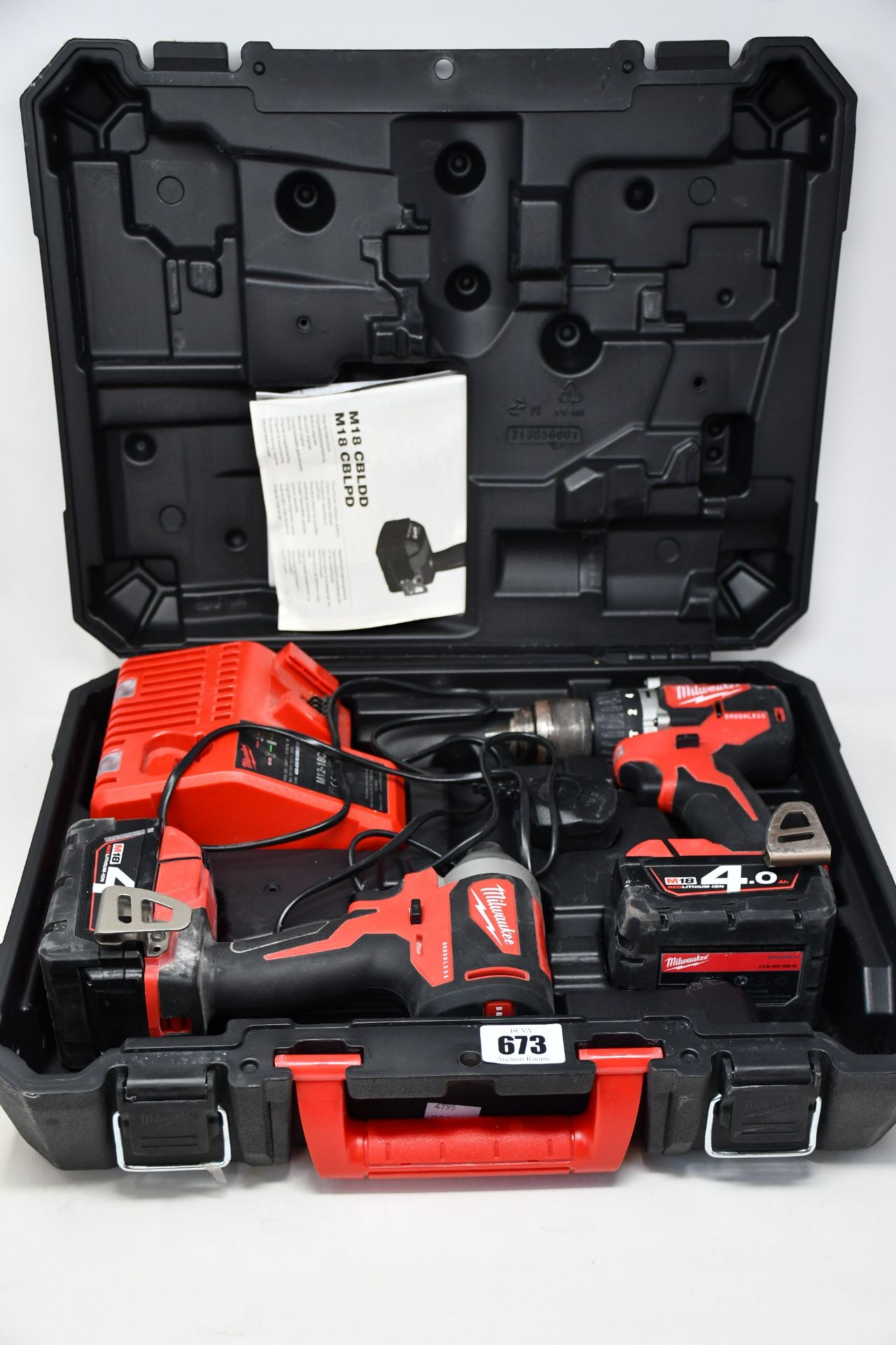 Two boxed Milwaukee M18BLPD2-0 M18 compact brushless percussion drills to include two Milwaukee