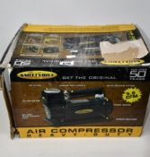 One boxed as new Smittybilt high performance air compressor (Model: 2781).