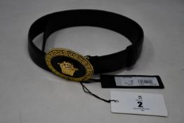 An as new Versace Medusa round buckle belt (RRP £355).