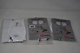 A large quantity of Ecolog reusable face masks in white.