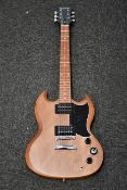 One boxed as new Epiphone SG Special VE electric guitar in vintage walnut.