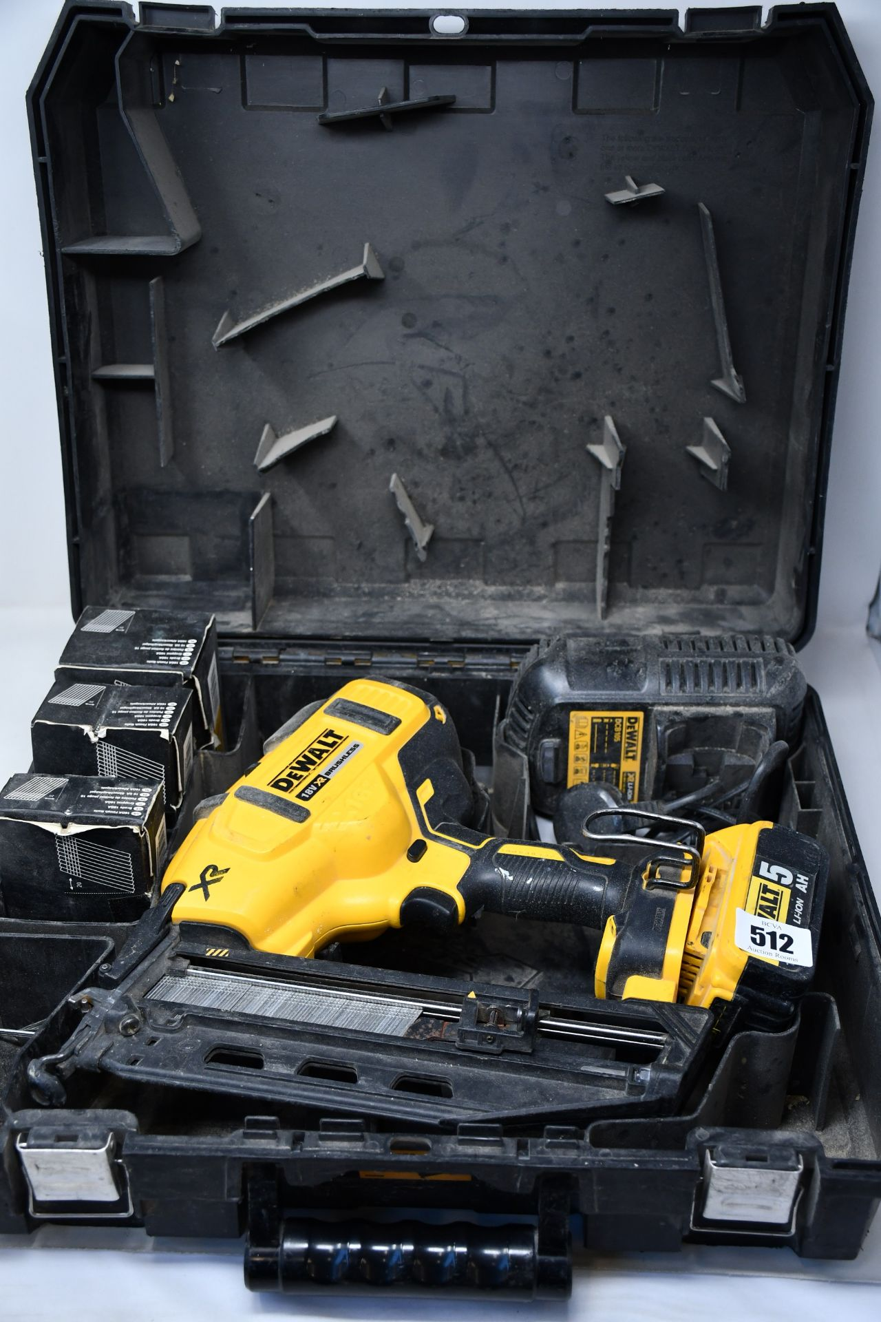 A pre-owned DeWalt angled nail gun (DCN66OP2) kit with rechargeable battery and charger.