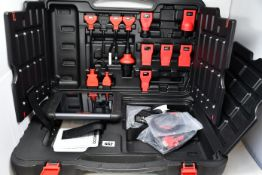 A boxed AUTEL MS906 MaxiSys automotive diagnostic system and scan tool kit.