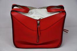 An as new Loewe small Hammock bag in red (RRP £1850).