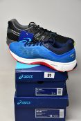 Two pairs of as new Asics trainers; GT-1000 7 (UK 7) (As new but has some marks on the back of right