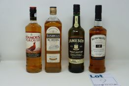 Five bottles of miscellaneous whiskeys to include The Famous Grouse, Bushmills The Original and