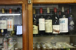 A large quantity of miscellaneous wines and related items, approximately 25 bottles (Over 18s