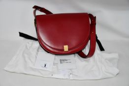 An as new Victoria Beckham Half Moon handbag in rub red Palmellato leather with dust bag.