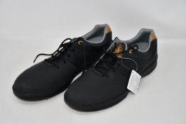A pair of as new Contour Foot Joy golf shoes (UK 11 - No box).