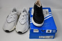Two pairs of as new Junior Adidas trainers; Ozweego (UK 5 - No box, slight marks on top of back
