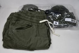 Three pairs of as new G-Star Raw Rovic trousers (W32/L32) and a pair of Rovic shorts (W32).