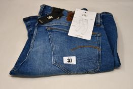 Four pairs of as new G-Star Raw jeans (All W34/L32).