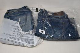 Four pairs of as new G Star Raw jeans (W27/L28, W30/L32, W32/L28, W40/L34).