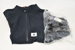 A women's as new Under Armour golf rain jacket (M - RRP £130) and a pair of women's Under Armour