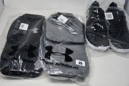 A pair of as new Under Armour Charged trainers (UK9, no box) and four Under Armour golf shoe bags (