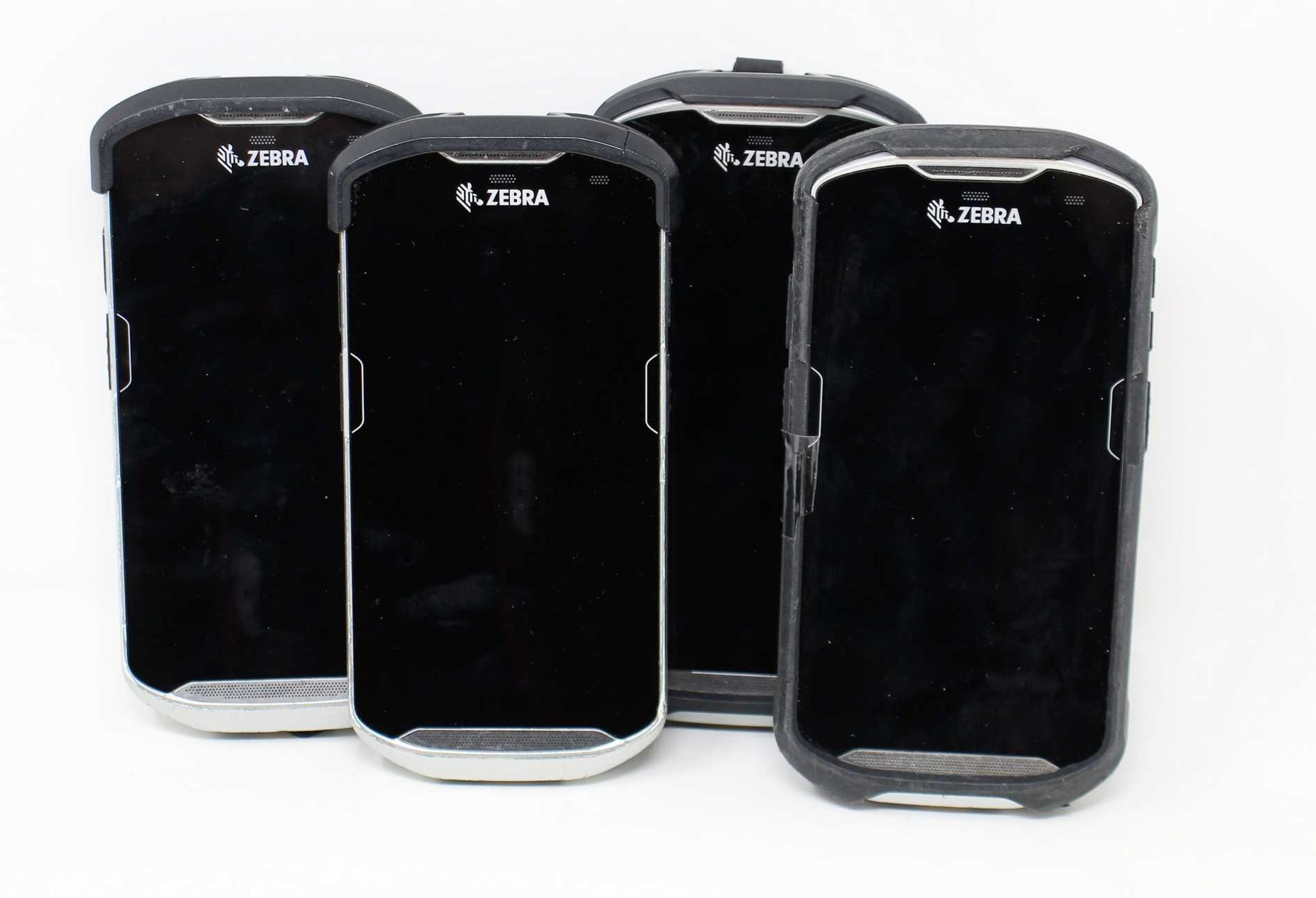 SOLD FOR PARTS: Four pre-owned Zebra TC510K Mobile Handheld Computer Barcodes Scanners (M/N:
