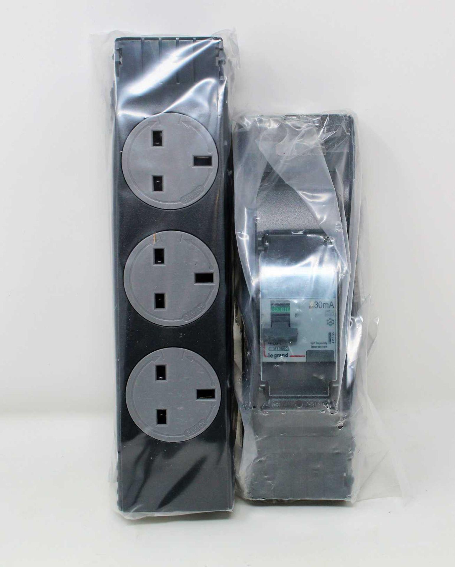 Twenty Electrak 3 Gang Rotatable Socket Modules (IAB503R) and six Electrak Protection Modules with