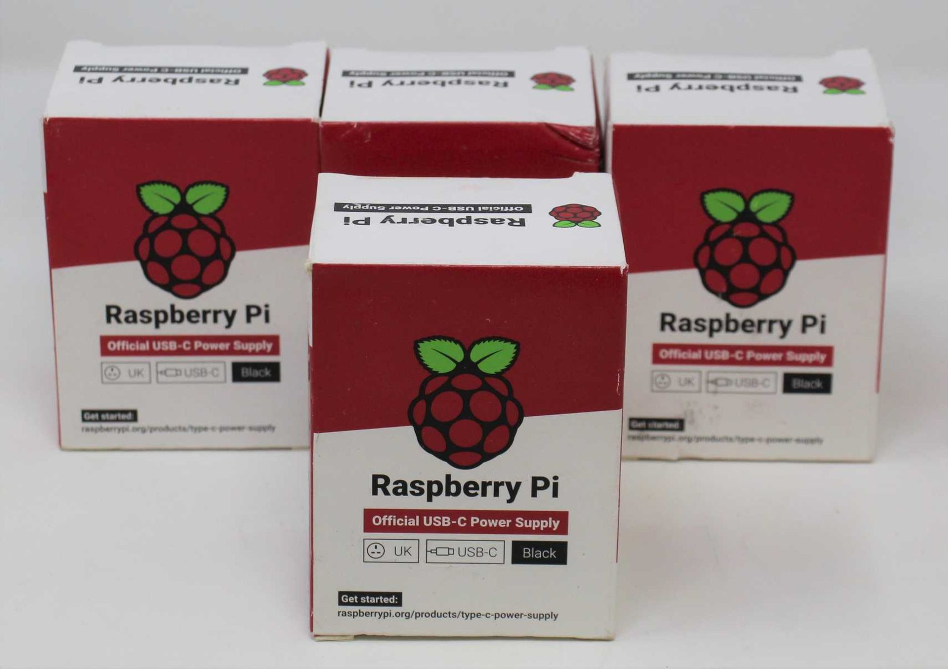 Four boxed as new Raspberry Pi 15.3W USB-C Power Supplies (UK model, Black) (Some damage to boxes).