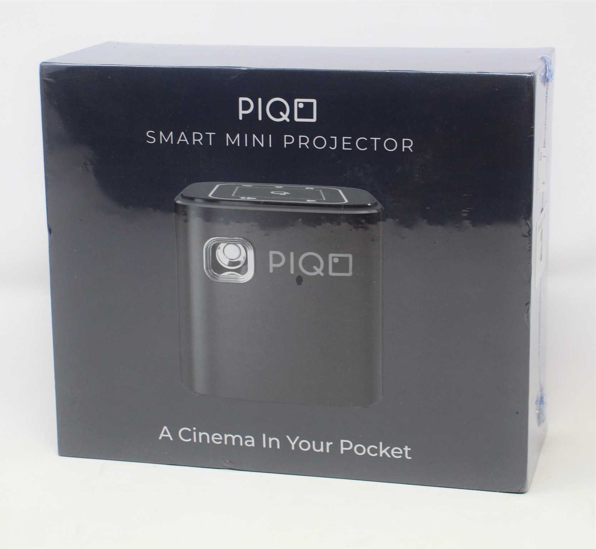 A boxed as new Piqo Smart Android Mini Projector (UK plug adaptor required) (Box sealed).