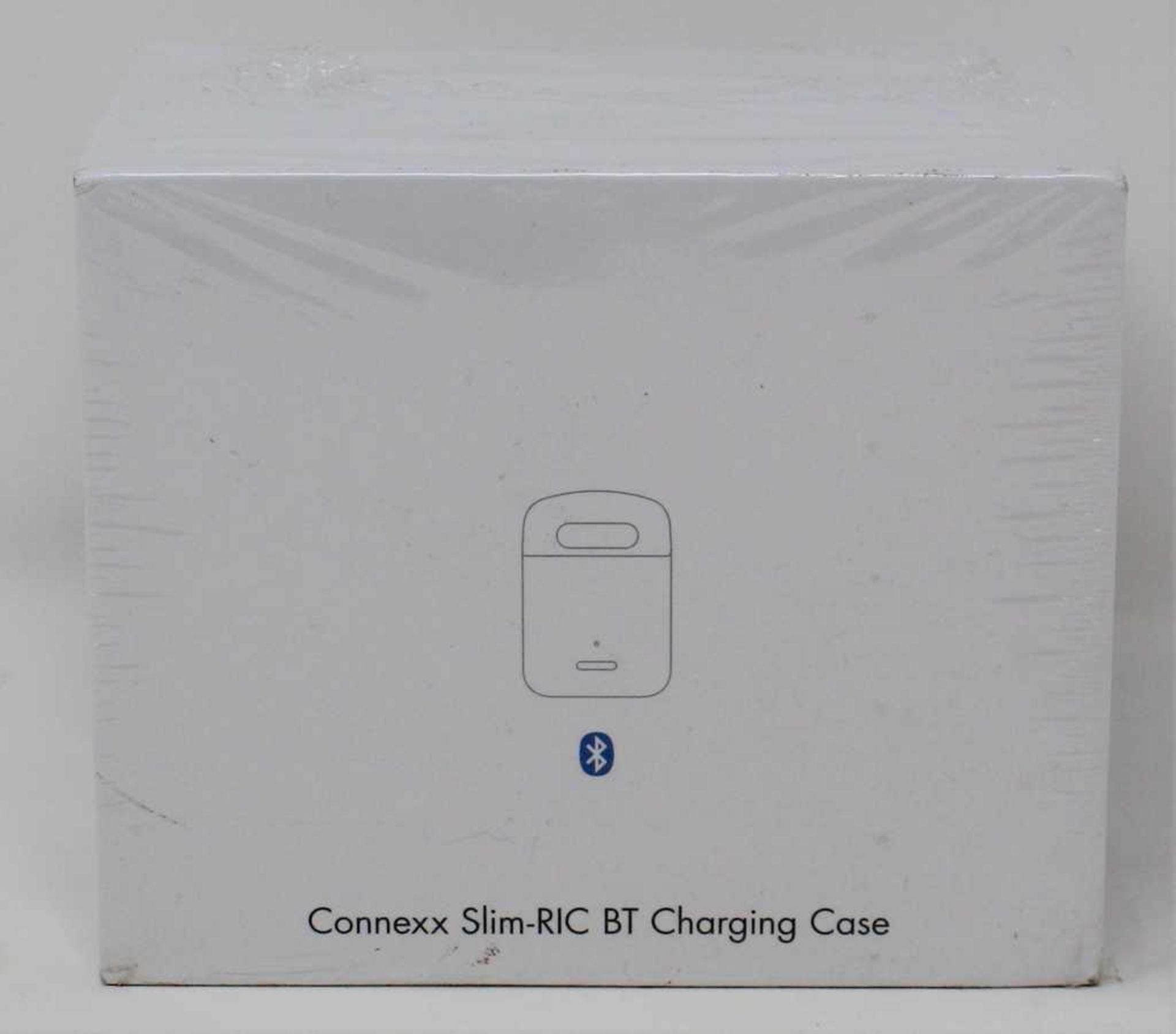 A boxed as new Connexx Slim-RIC BT Charging Case (REF: 10966368) (Box sealed).