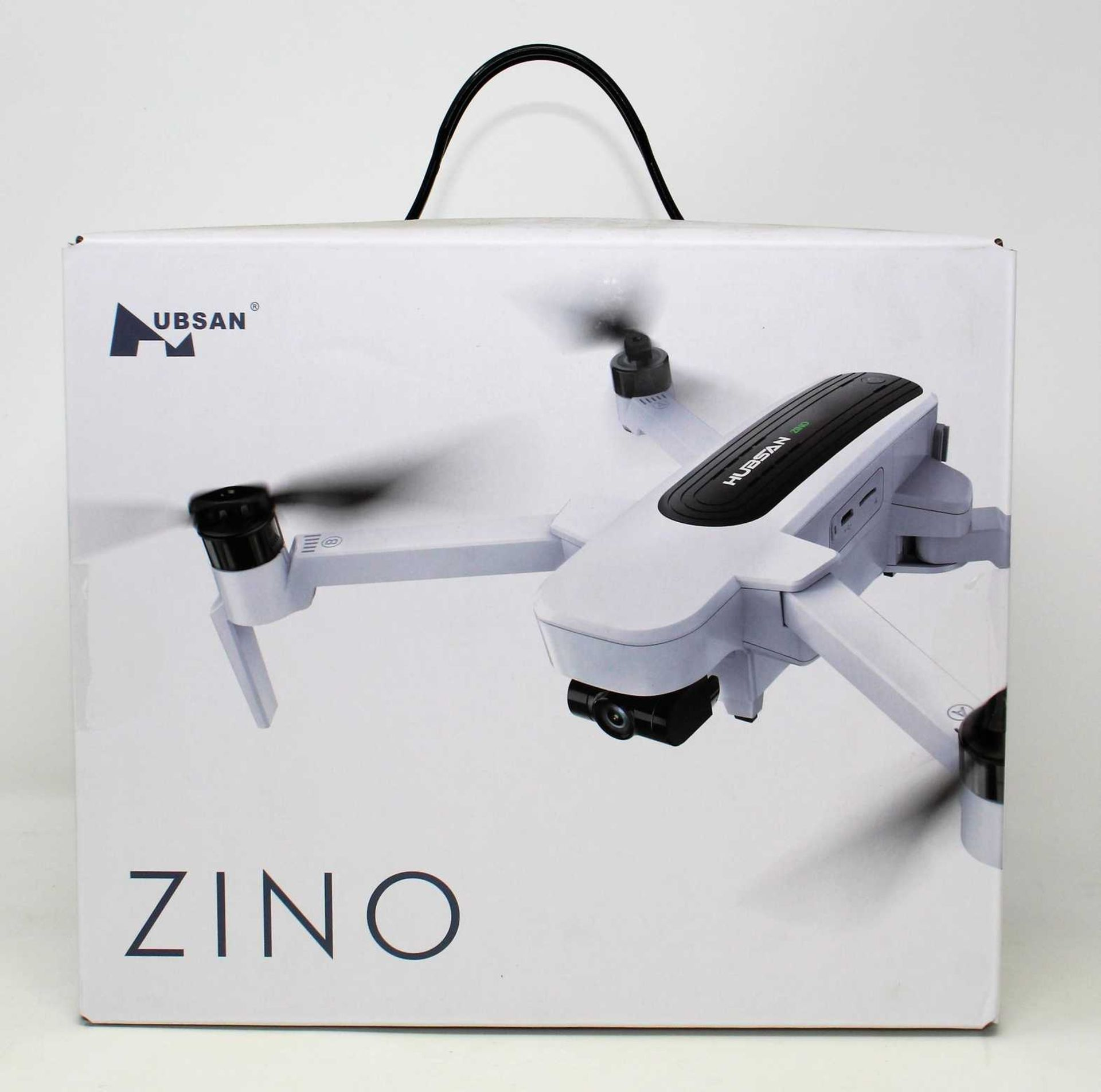 A boxed as new Hubsan Zino H117S Folding Quadcopter Drone (Box sealed. UK plug adapter required).