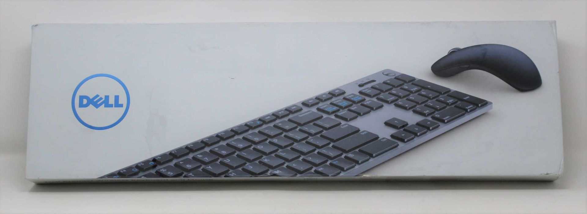 A boxed as new Dell KM717 Premier Keyboard And Mouse Set (VPN: KM717-GY-UK) (Box sealed, some damage