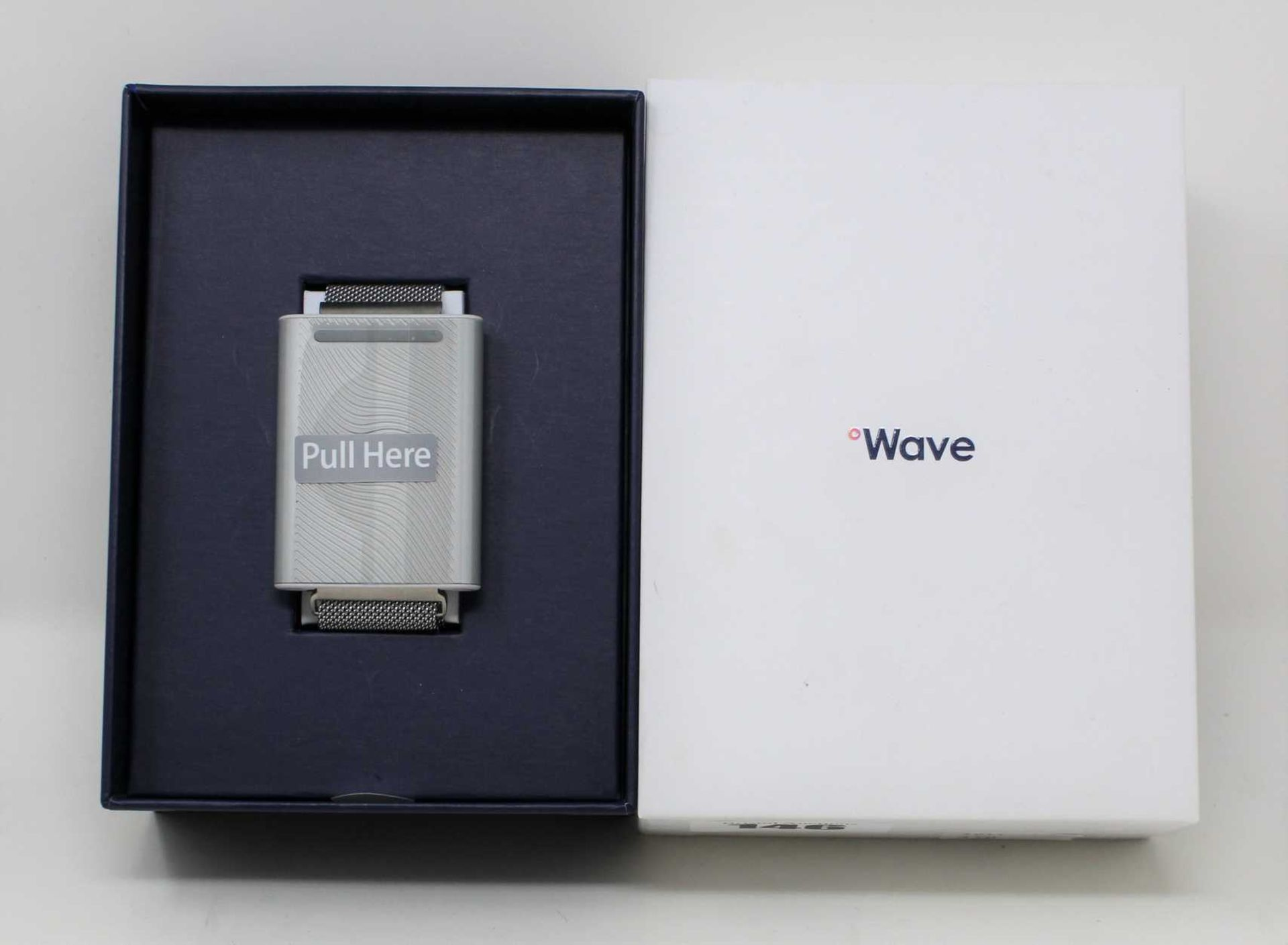 A boxed as new Embr Wave Temperature Control Bracelet in Silver (Box opened).