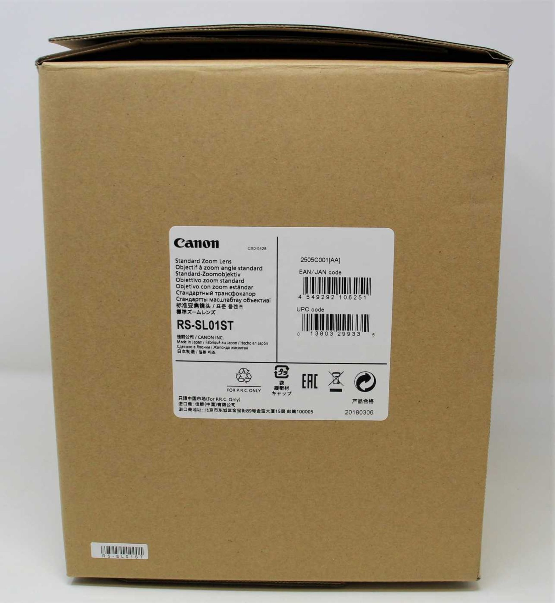 A boxed as new Canon RS-SL01ST Standard Zoom Projector Lens (2505C001[AA]) (Box opened).