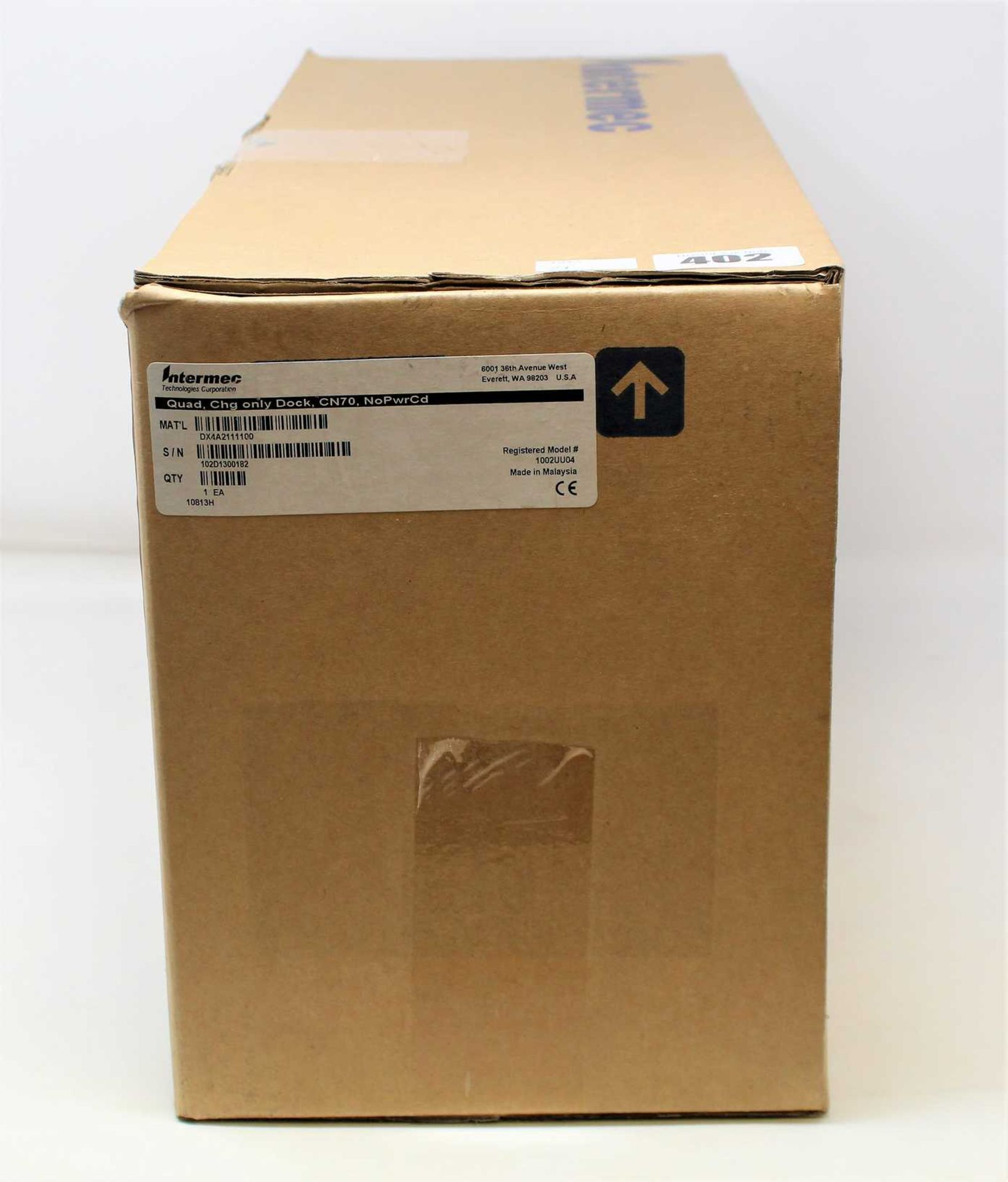 A boxed as new Intermec DX4A2111100 4 Bay CN70 Barcode Scanner Cradle Charger (Box sealed).