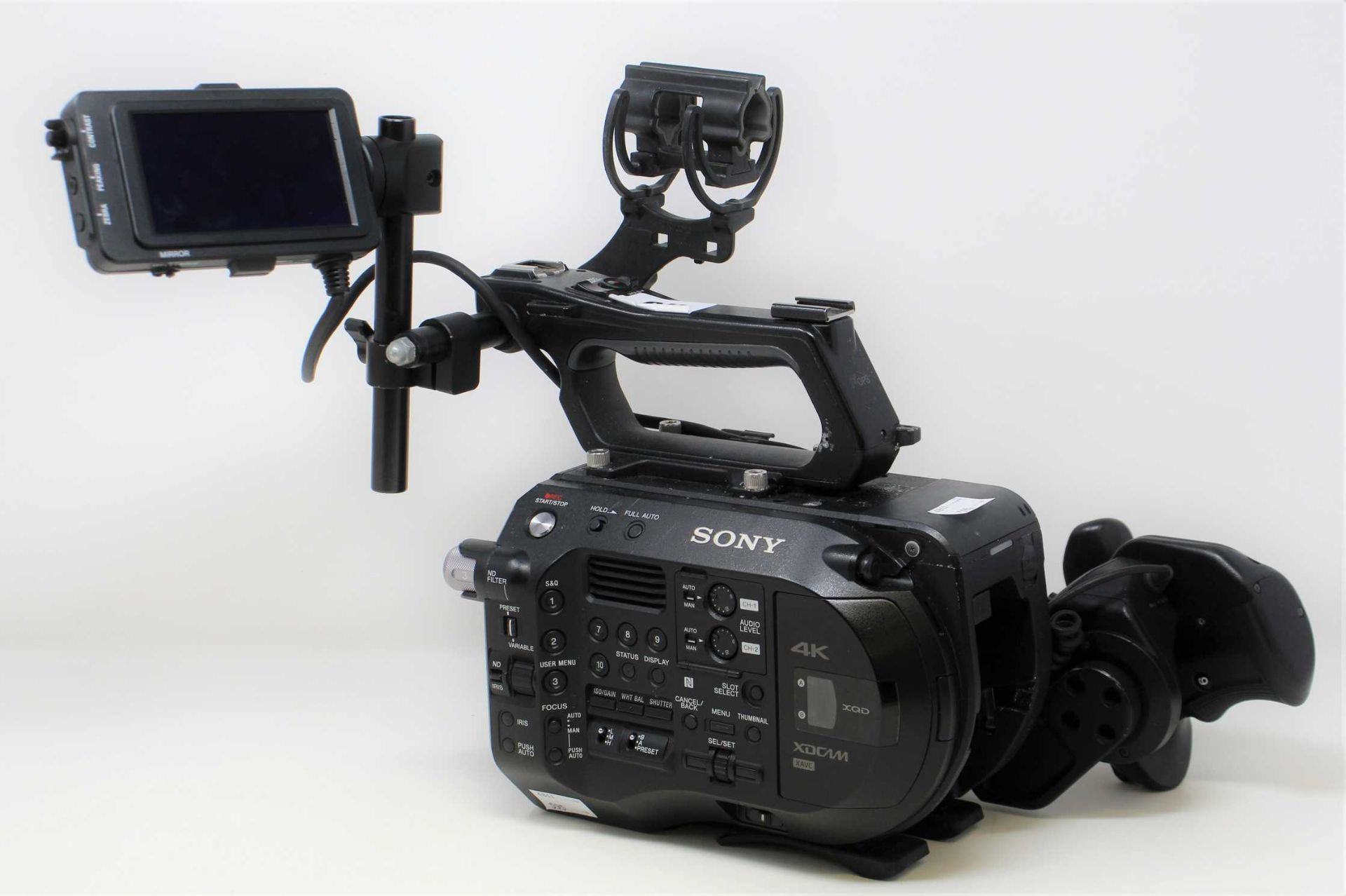 A pre-owned Sony PXW-FS7 II XDCAM 4K Super 35 E-mount Camera Body with Grip and LCD Monitor (M/N: