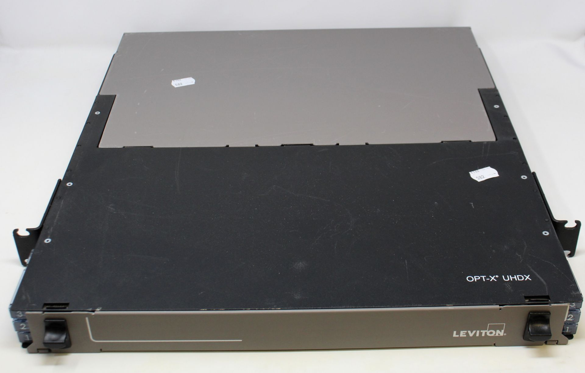 A pre-owned Leviton OPT-X UHDX 1RU Fiber Enclosure (Untested, sold as seen).