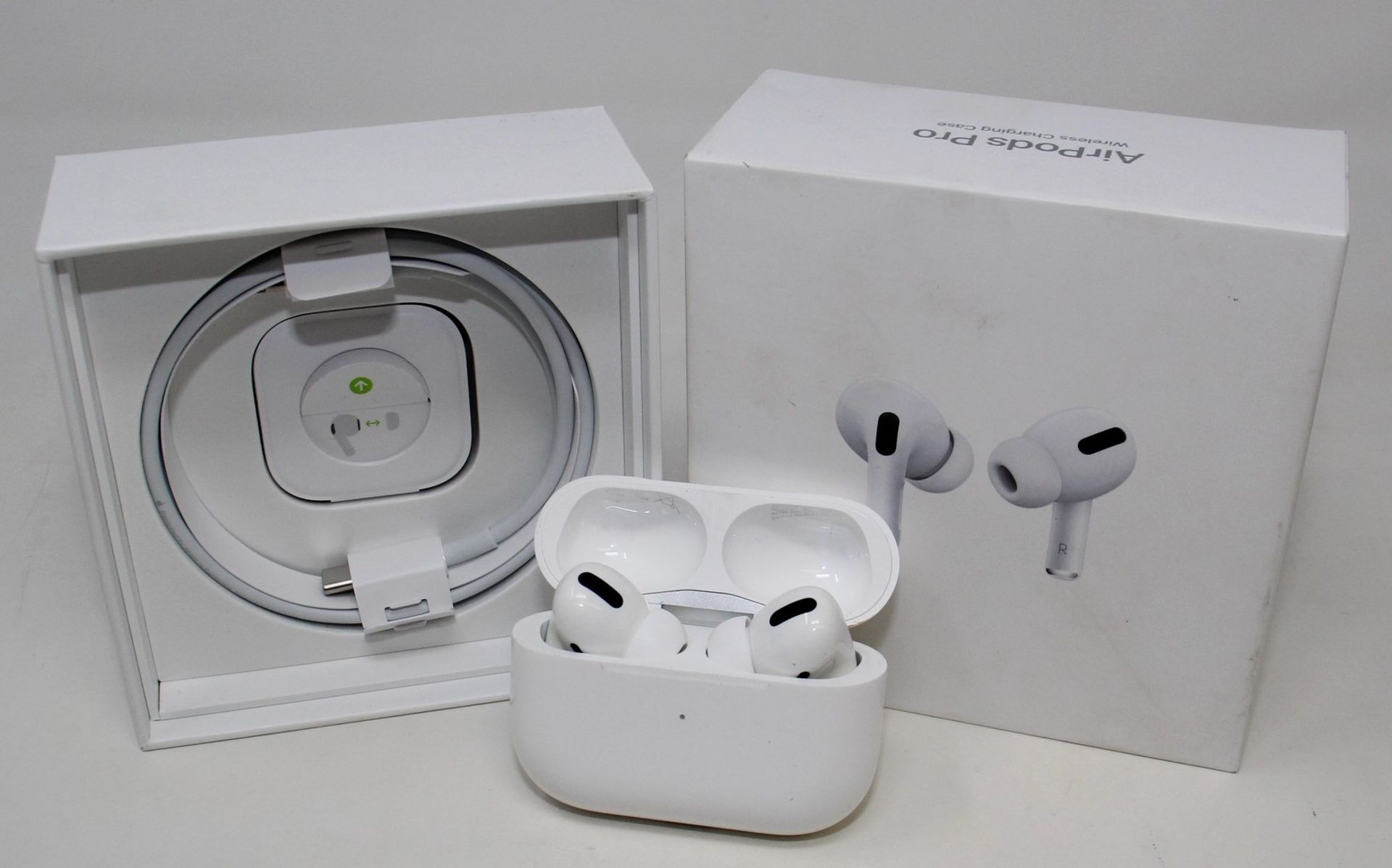 A pre-owned pair of Apple Airpods Pro with Wireless Charging Case (A2083 A2084 A2190) (box, as new