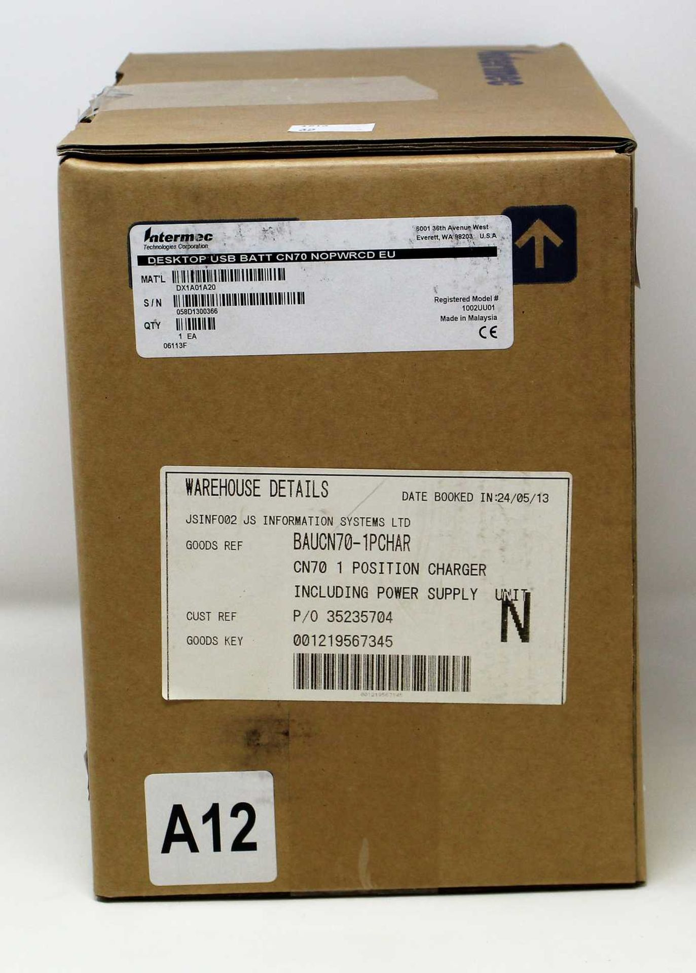 A boxed as new Intermec DX1A01A20 Single Bay CN70 Barcode Scanner Charger and Battery Charger.