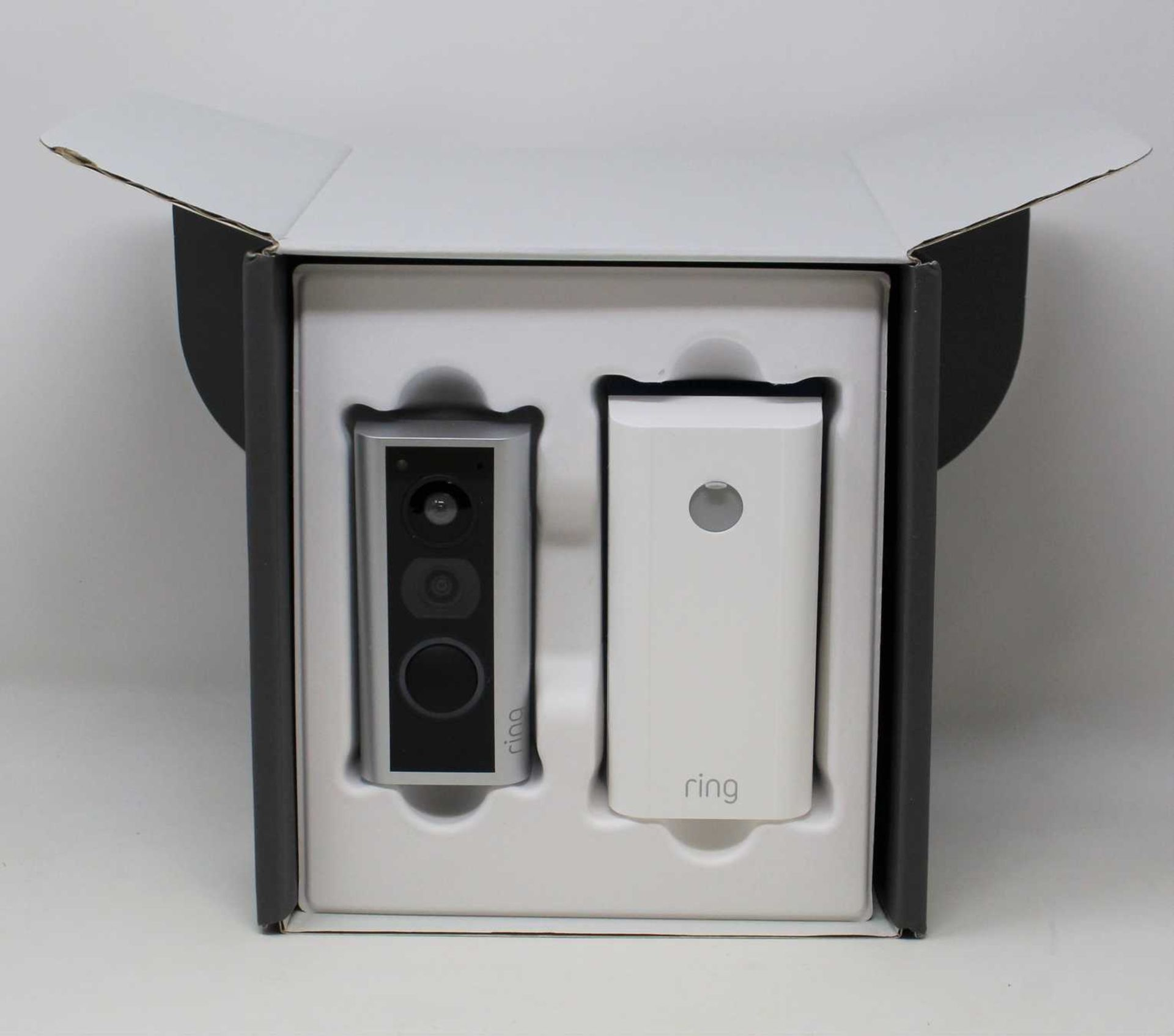 A boxed Ring Door View Cam in Silver (Appears as new. Damaged box).