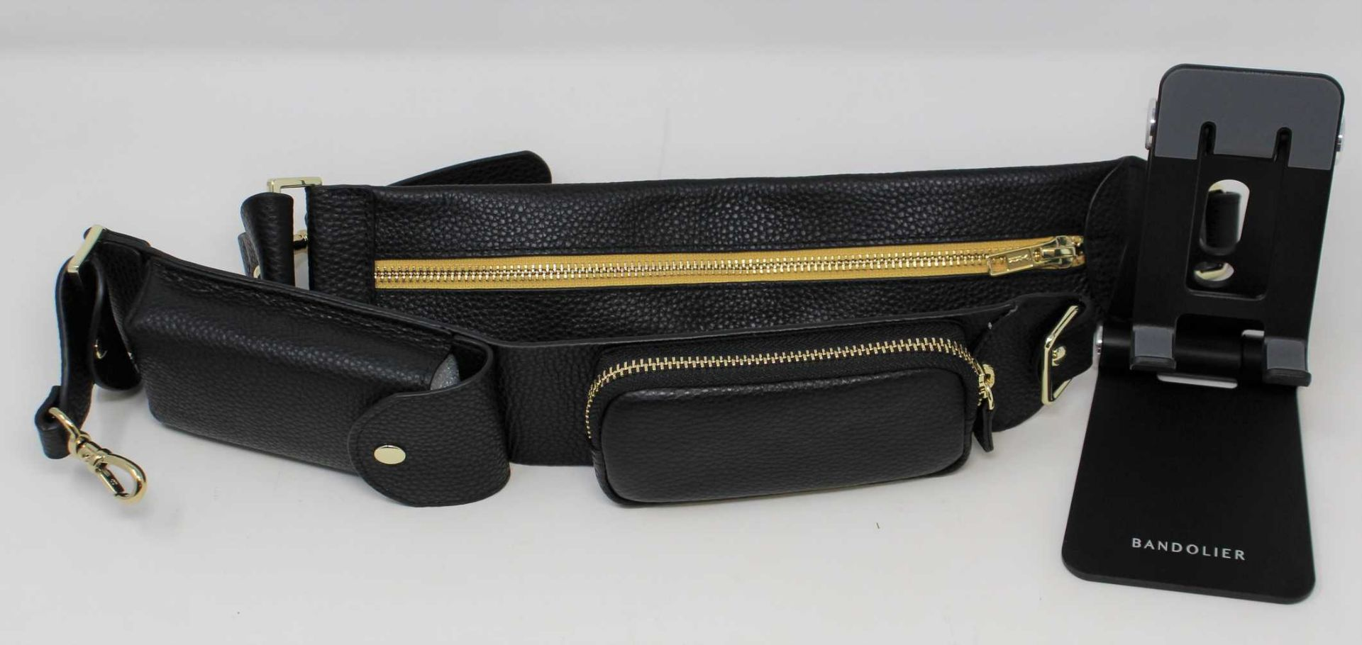 An as new Bandolier Billie Crossbody Utility Strap in Black/Gold (Strap only, phone case not