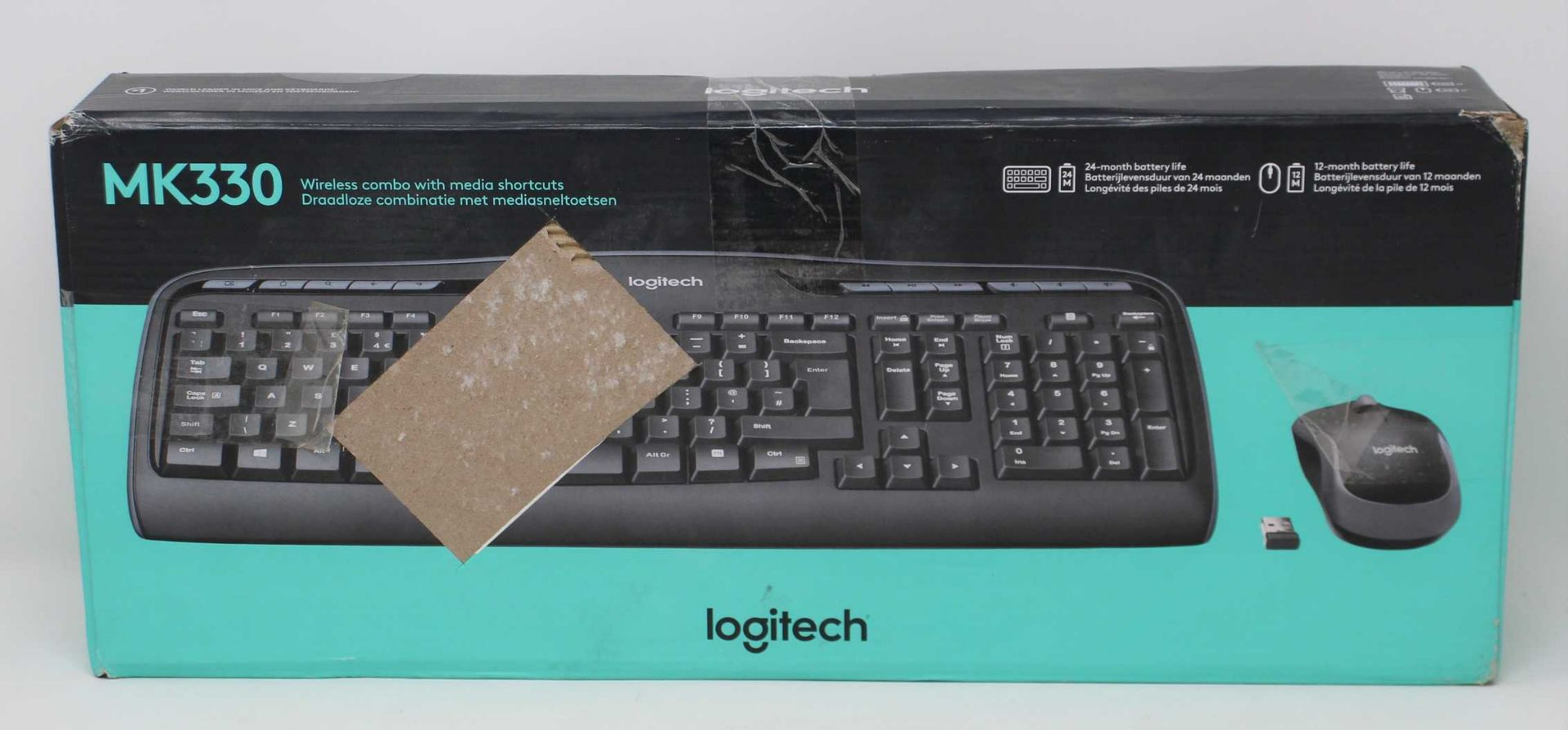 A boxed as new Logitech Wireless Combo MK330 Keyboard & Mouse Set in Black (Box sealed. damaged