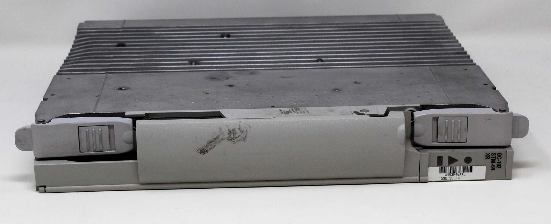 A pre-owned Nortel Optera NTCA04KP WMR3F1AAD 1552 .52NM OC-192 STM-64 XR (Untested, sold as seen).